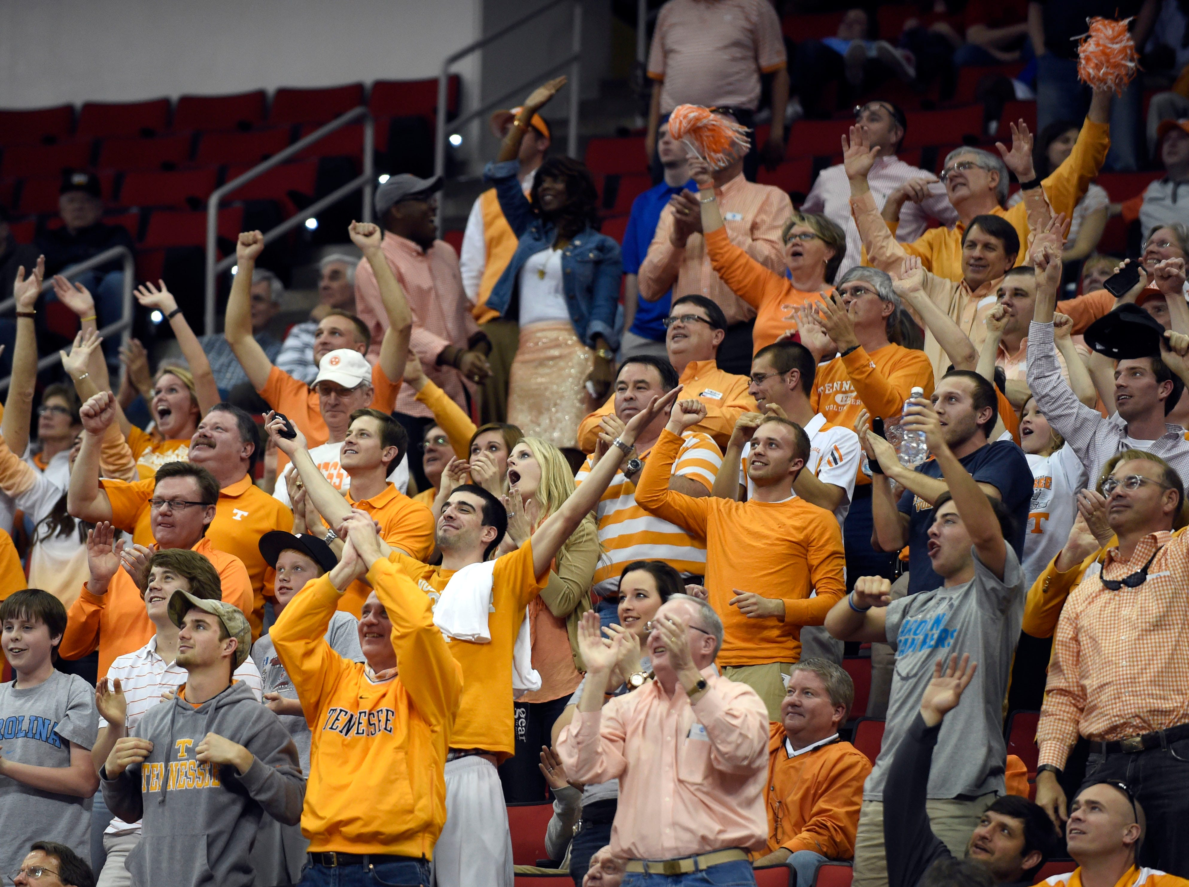 Tennessee fans celebrate their team's 86-67 win over Massachusetts during the second half of an NCAA tournament game at the PNC Arena in Raleigh, N.C. on Friday, March 21, 2014.