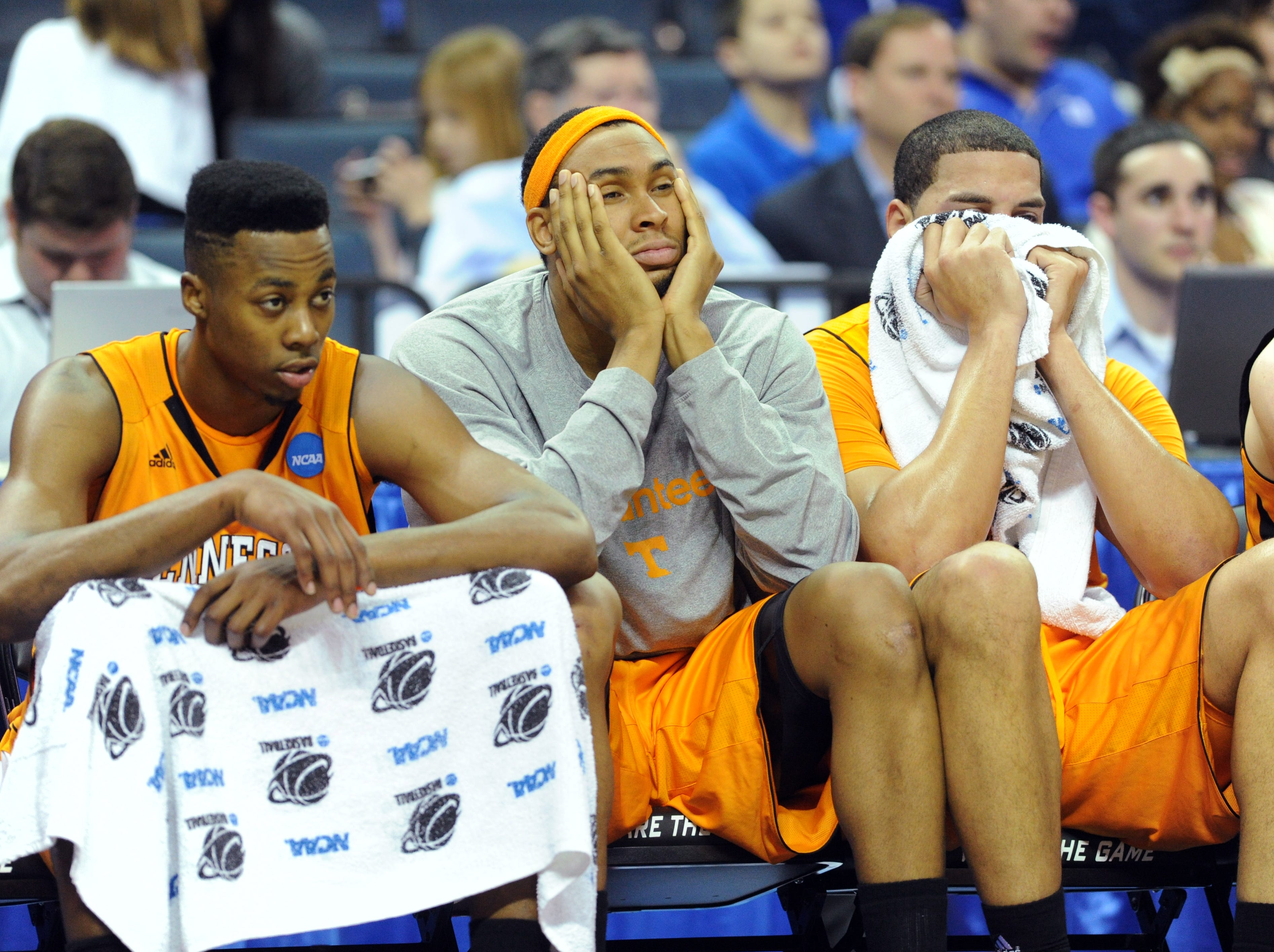 Tennessee's Scoty Hopson, John Fields and Brian Williams, left to right, look on as the Vols play the Michigan Wolverines during the second round of the NCAA Tournament at Time Warner Cable Arena in Charlotte, N.C. Friday, March 18, 2011.  The Vols lost 75-45 to the Wolverines knocking them out of the tournament.