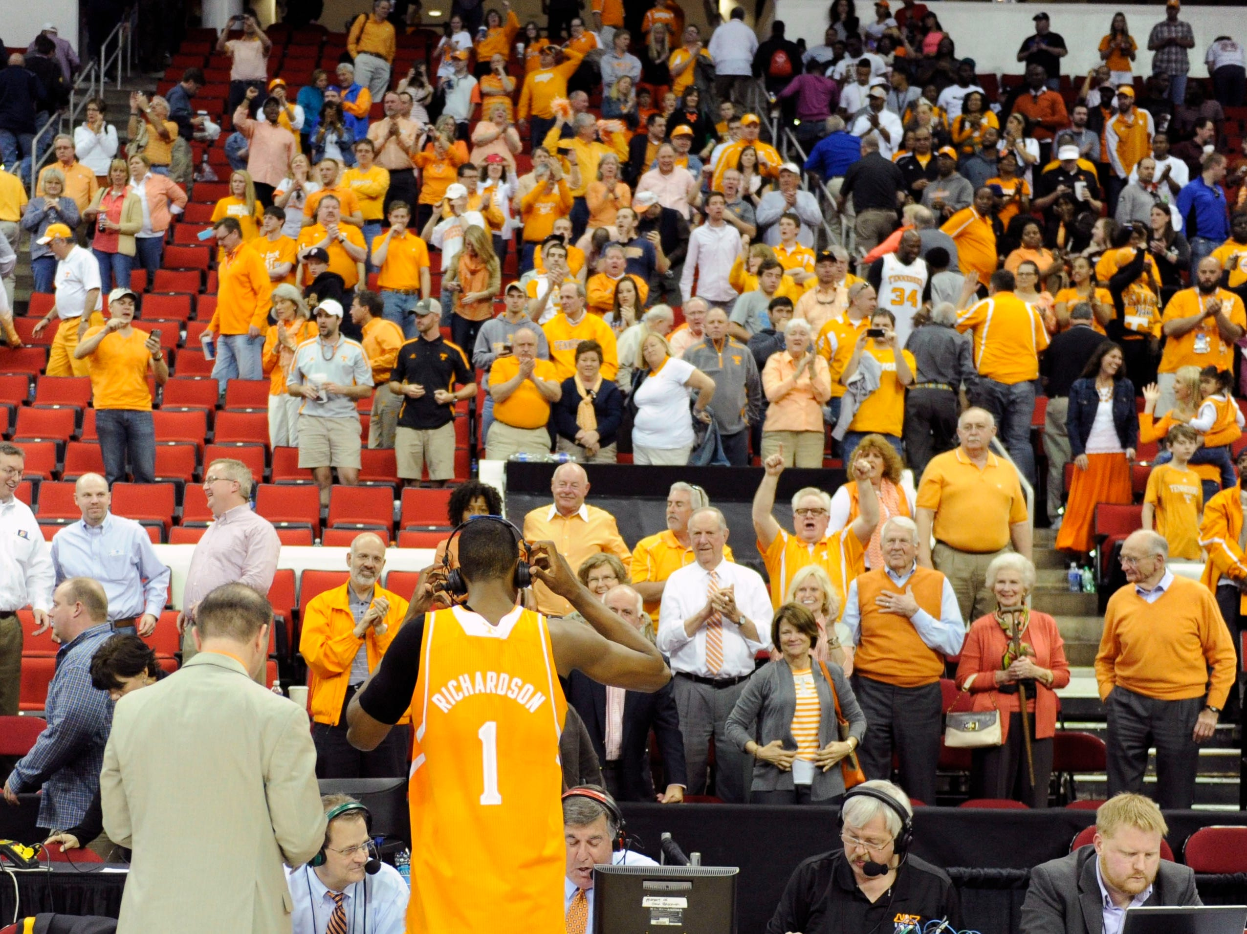 Tennessee fans applaud Tennessee guard Josh Richardson (1) following Tennessee's 86-67 defeat of Massachusetts in the second half of an NCAA tournament game at the PNC Arena in Raleigh, N.C. on Friday, March 21, 2014.