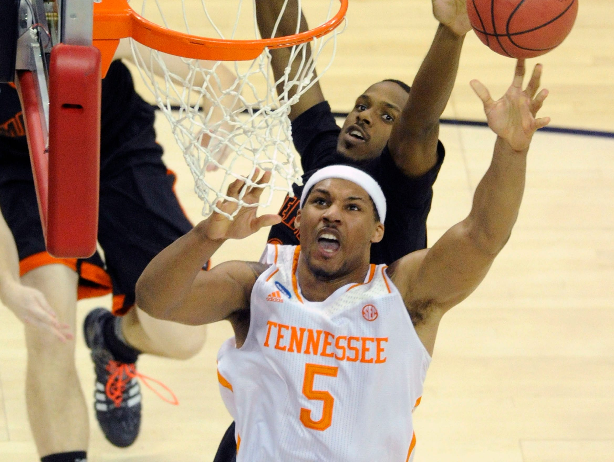Tennessee forward Jarnell Stokes (5) shoots a layup against Mercer during the second half of a third-round NCAA tournament game at the PNC Arena in Raleigh, N.C. on Sunday, March 23, 2014. Tennessee won 83-63.