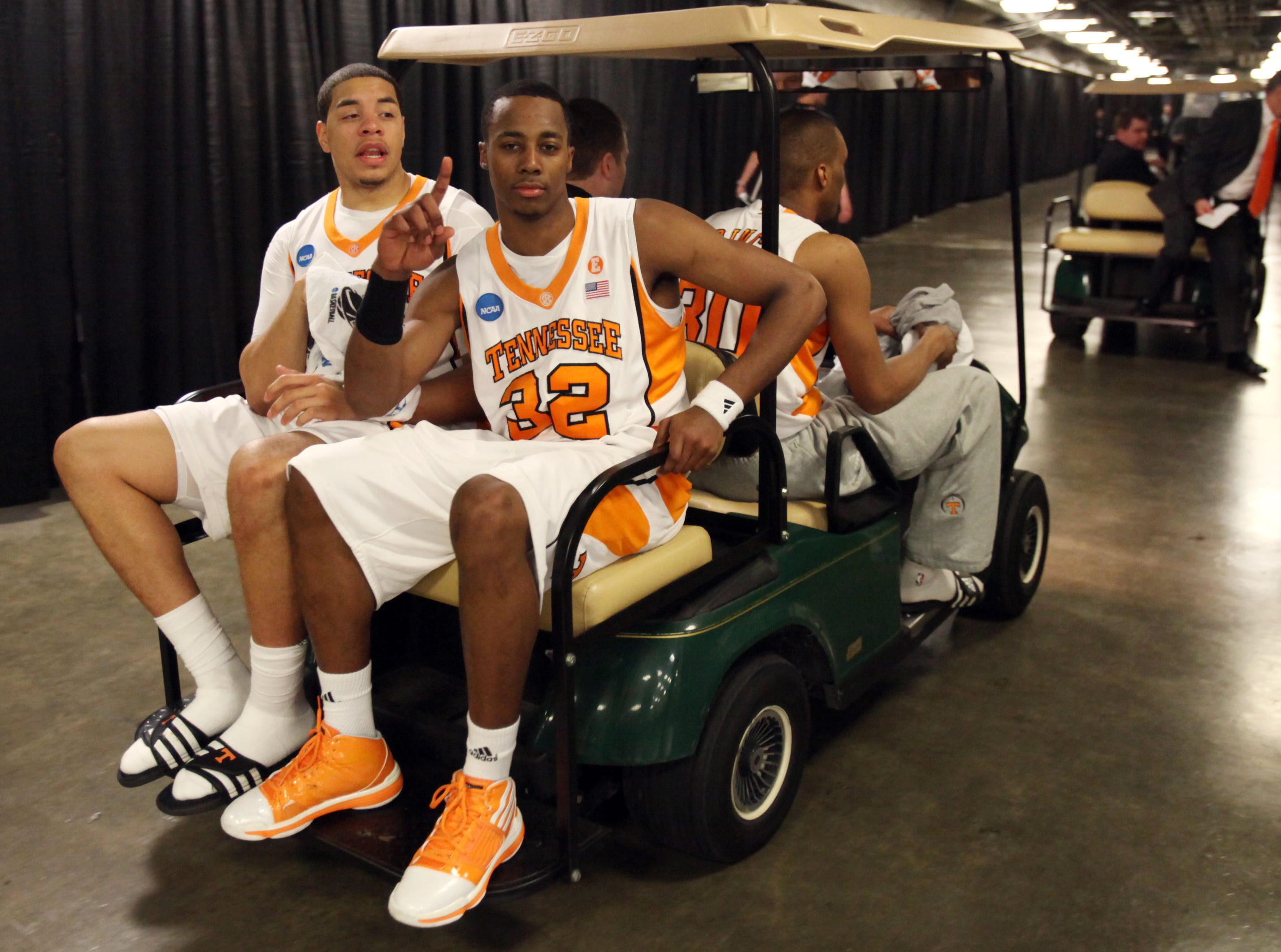 Scotty Hopson holds up one finger as he rides with teammate Brian Williams to a press conference after the Vols defeated the Ohio Bobcats 83-68 during the second round of the NCAA tournament in Providence, R.I. Saturday, Mar. 20, 2010.