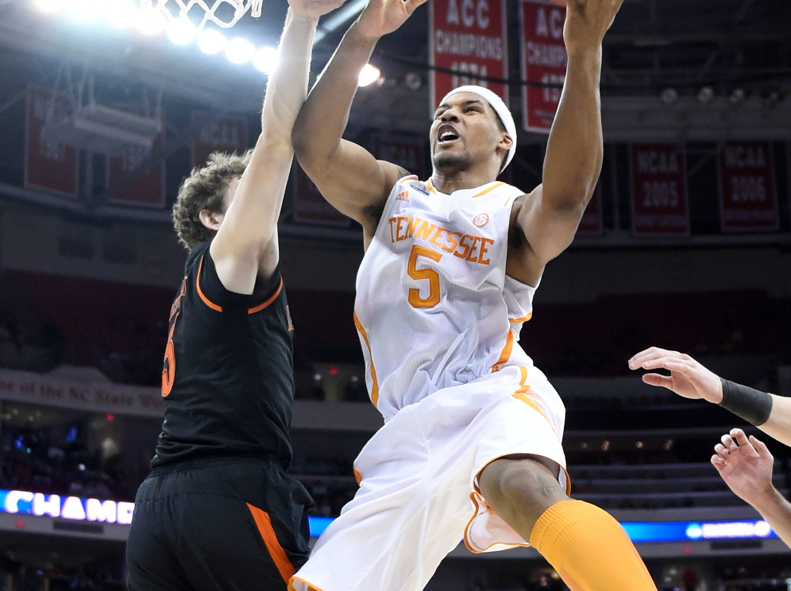 Tennessee forward Jarnell Stokes (5) goes to the hoop against Mercer defense during the first half of a third-round NCAA tournament game at the PNC Arena in Raleigh, N.C. on Sunday, March 23, 2014.