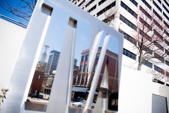 A view of Market Square reflected in the TVA sign in downtown Knoxville, Tennessee on Monday, March 18, 2019.