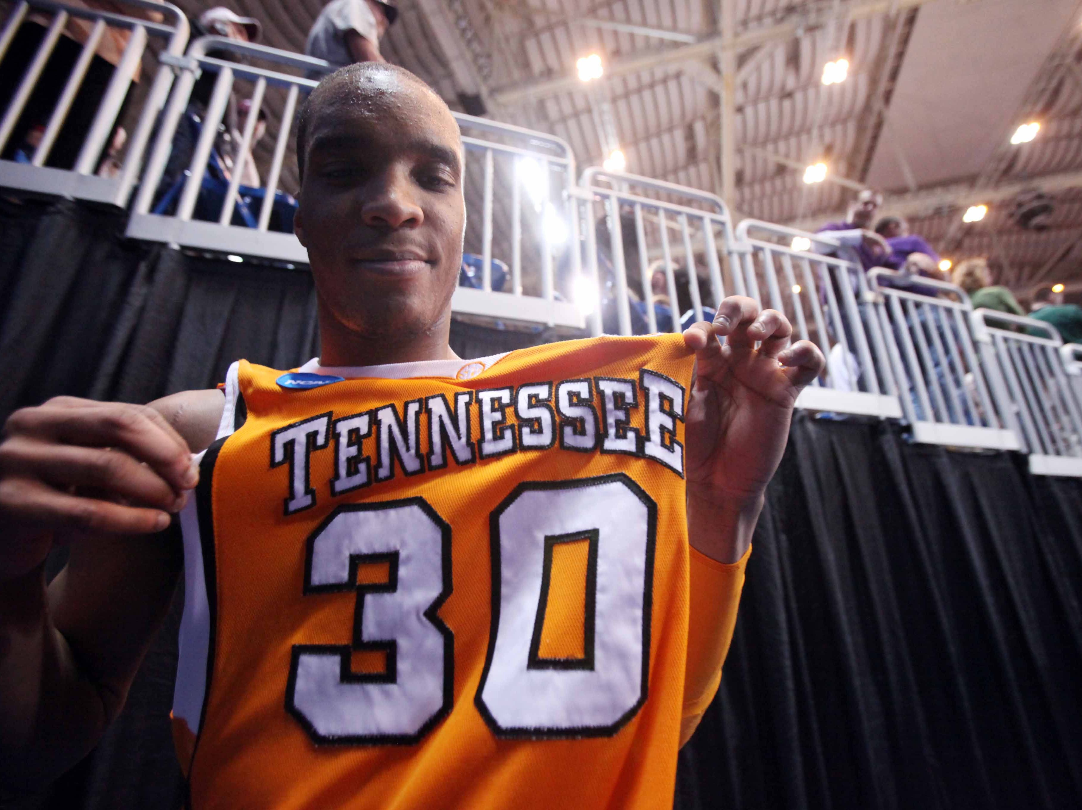 J.P. Prince holds out his jersey after the Vols defeated the Ohio State Buckeyes 76-73 during the NCAA tournament Sweet Sixteen at the Edward Jones Dome in St. Louis, Mo., Friday, Mar. 26, 2010.  Prince scored 14 points during the game.