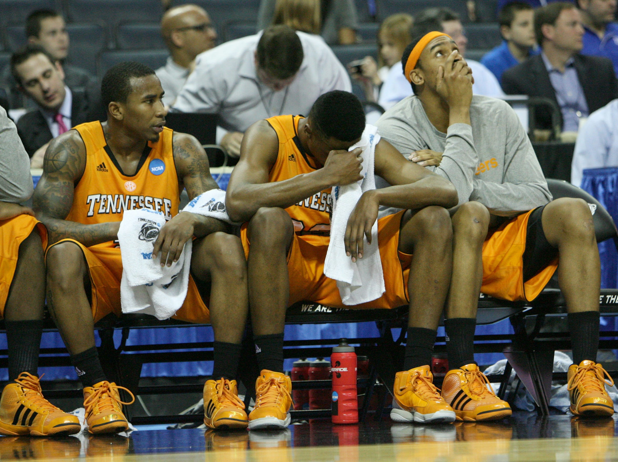 Tennessee's Melvin Goins, Scotty Hopson and John Fields, left to right, look on as the Vols play the Michigan Wolverines during the second round of the NCAA Tournament at Time Warner Cable Arena in Charlotte, N.C. Friday, March 18, 2011.  The Wolverines defeated the Vols 75-45 knocking them out of the tournament.