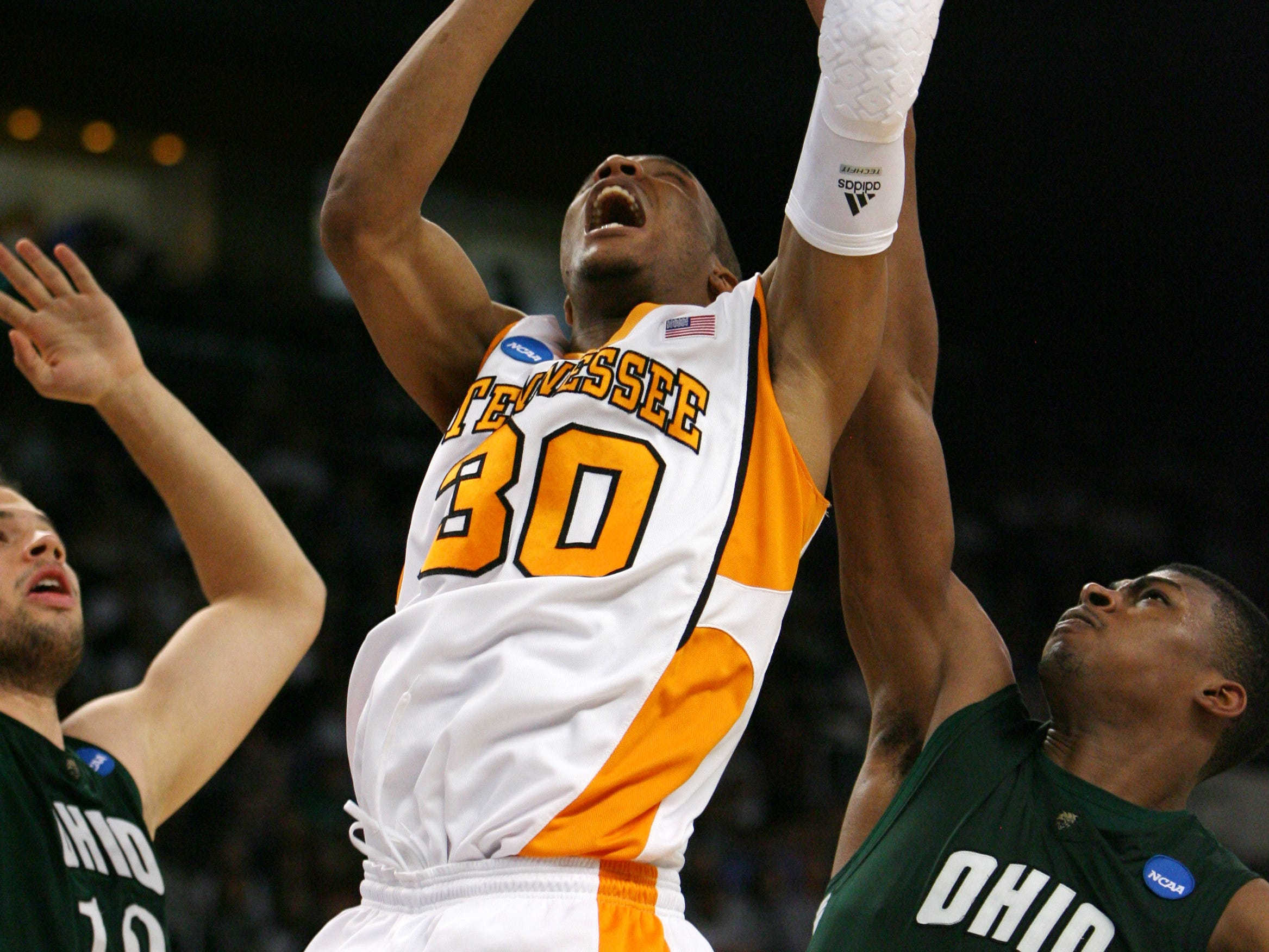 Tennessee's J.P. Prince goes in for a basket as Ohio's Kenneth van Kempen, left, and DeVaughn Washington, right, defend during the second round of the NCAA tournament in Providence, R.I. Saturday, Mar. 20, 2010.