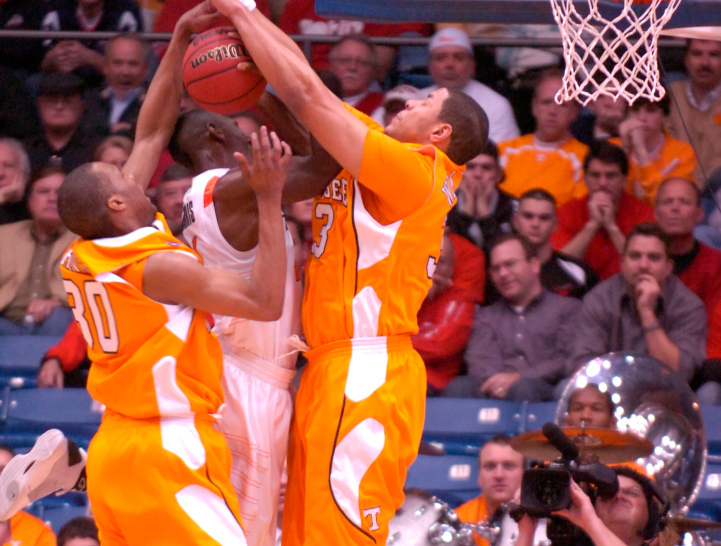 Tennessee's Brian Williams and J.P. Prince pressure Oklahoma State'sTerrel Harris as he tries to shoot during the first round of the 2009 NCAA tournament in Dayton, OH on Friday. UT lost the game 77-75 ending their post season play.