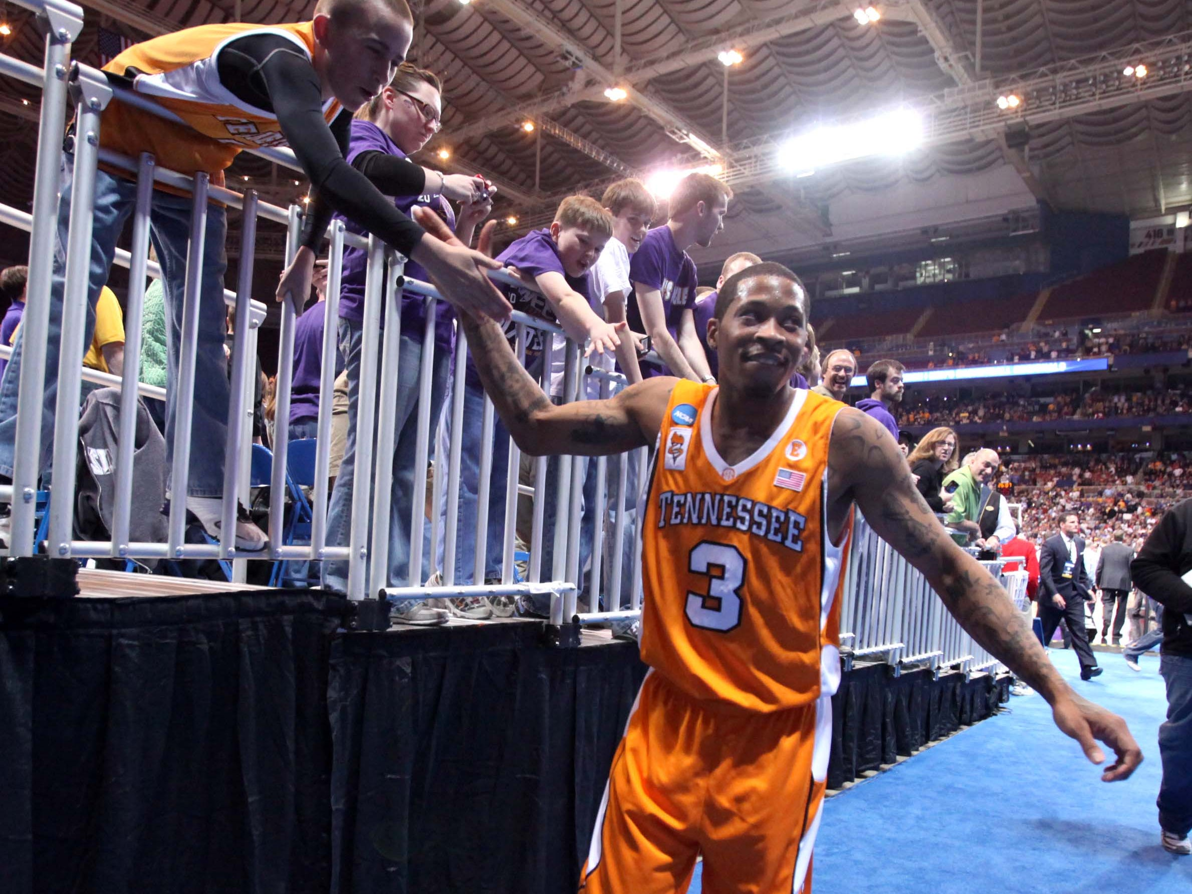 Bobby Maze high-fives a fan after the Vols defeated Ohio State during the NCAA tournament Sweet Sixteen at the Edward Jones Dome in St. Louis, Mo., Friday, Mar. 26, 2010.