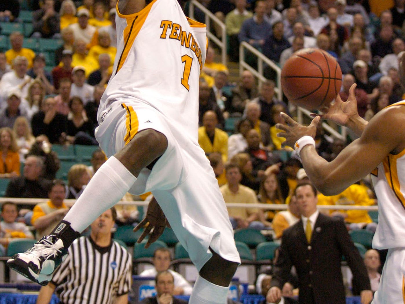 UT's Major Wingate hangs on the rim after a dunk against Winthrop during a first round NCAA tournament game Thursday at the Greensboro Coliseum in Greensboro, N.C. The Vols won the game 63-61. Wingate was the leading scorer for the Volunteers with 15 points.2006