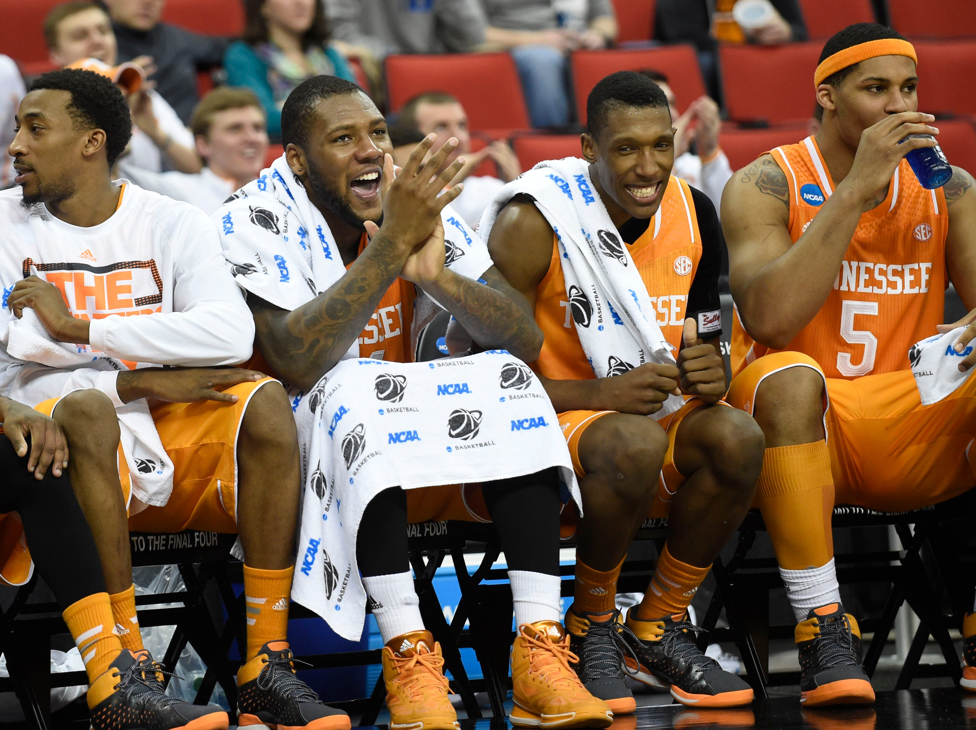 Tennessee guard Jordan McRae, Tennessee forward Jeronne Maymon, Tennessee guard Josh Richardson, and Tennessee forward Jarnell Stokes, from left, celebrate Tennessee's 86-67 win over Massachusetts during the second half of an NCAA tournament game at the PNC Arena in Raleigh, N.C. on Friday, March 21, 2014.