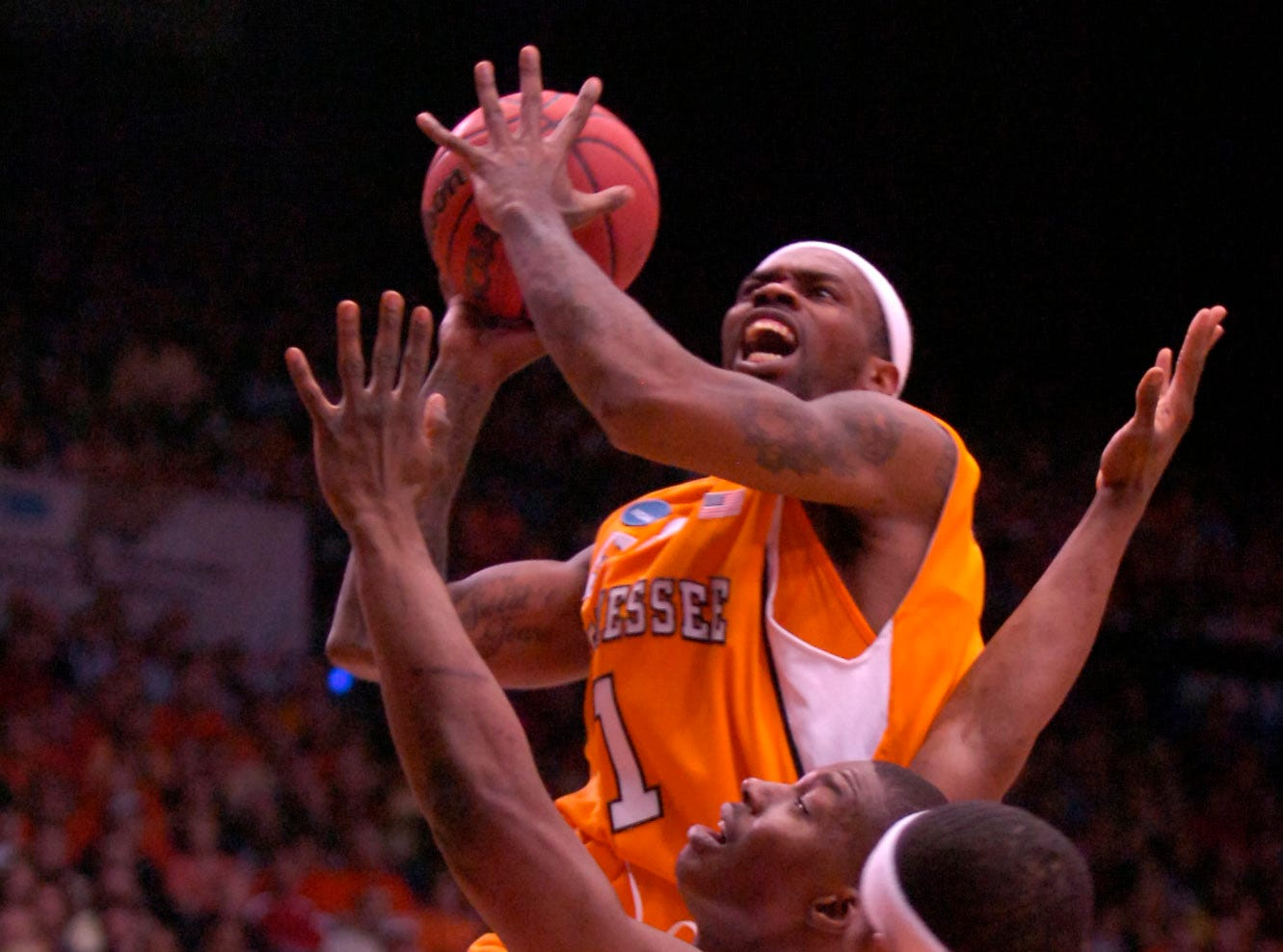 Tennessee's Tyler Smith gets to the basket against Oklahoma State during the first round of the 2009 NCAA tournament in Dayton, OH on Friday. UT lost the game 77-75 ending their post season play.