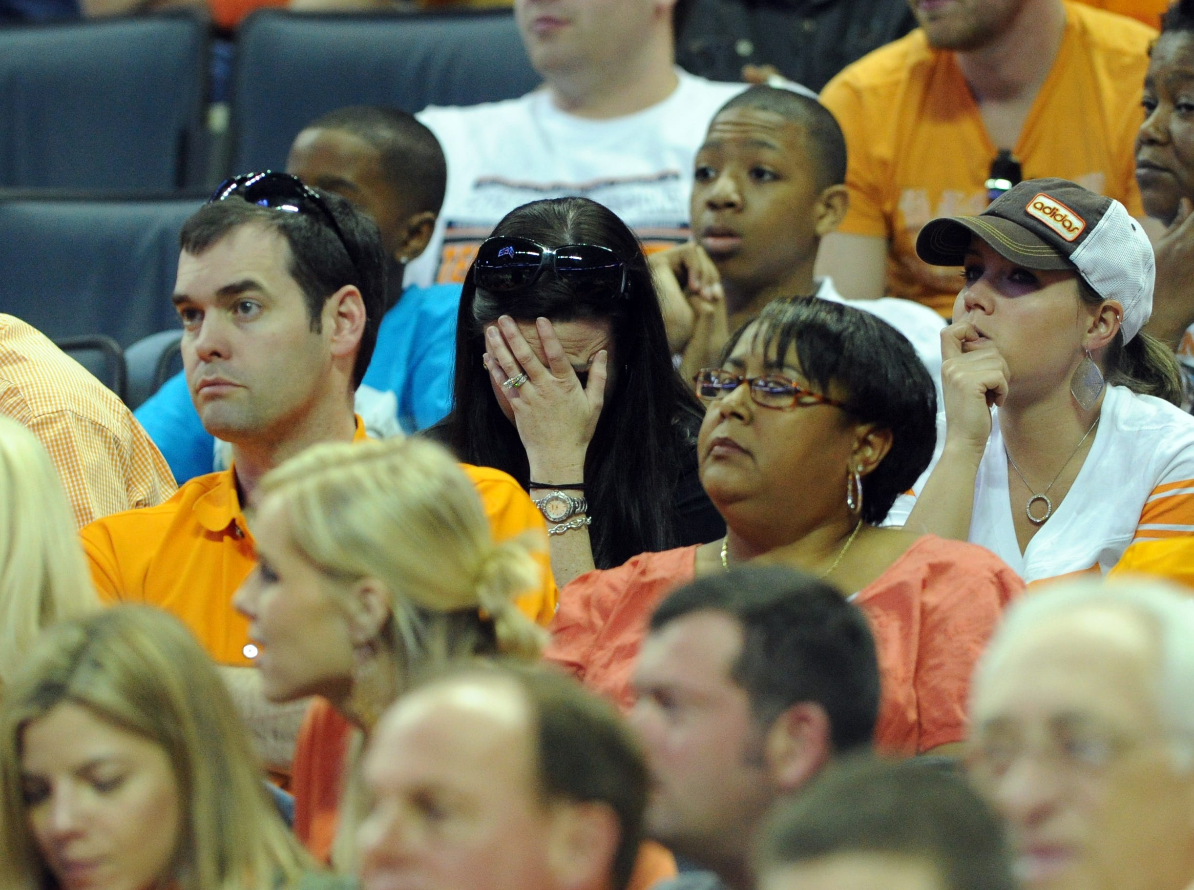 A Tennessee fan hangs her head as the Vols play the Michigan Wolverines during the second round of the NCAA Tournament at Time Warner Cable Arena in Charlotte, N.C. Friday, March 18, 2011.  The Wolverines defeated the Vols 75-45 knocking them out of the tournament.