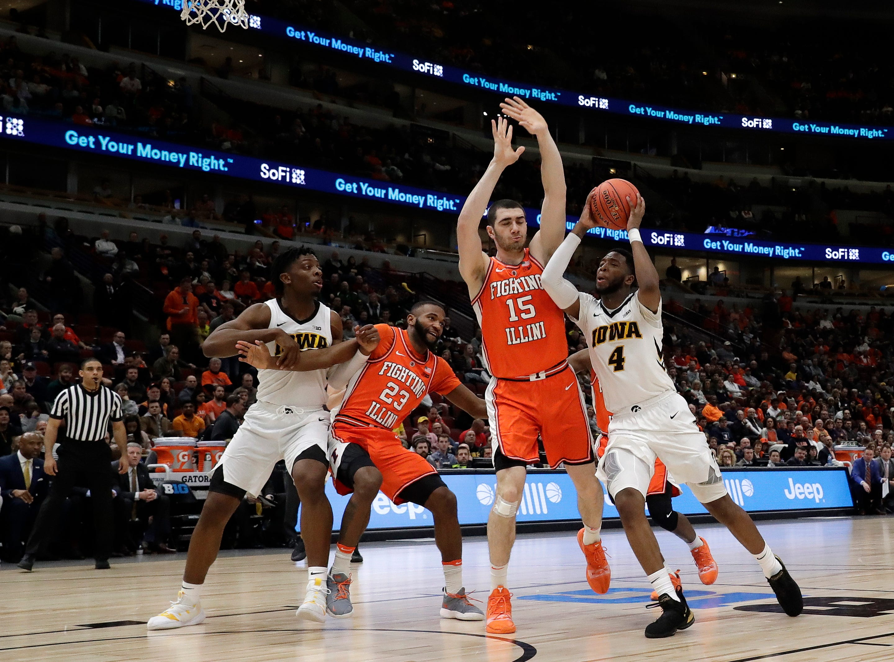 Iowa's Isaiah Moss (4) drives against Illinois's Giorgi Bezhanishvili (15) during the second half of an NCAA college basketball game in the second round of the Big Ten Conference tournament, Thursday, March 14, 2019, in Chicago.