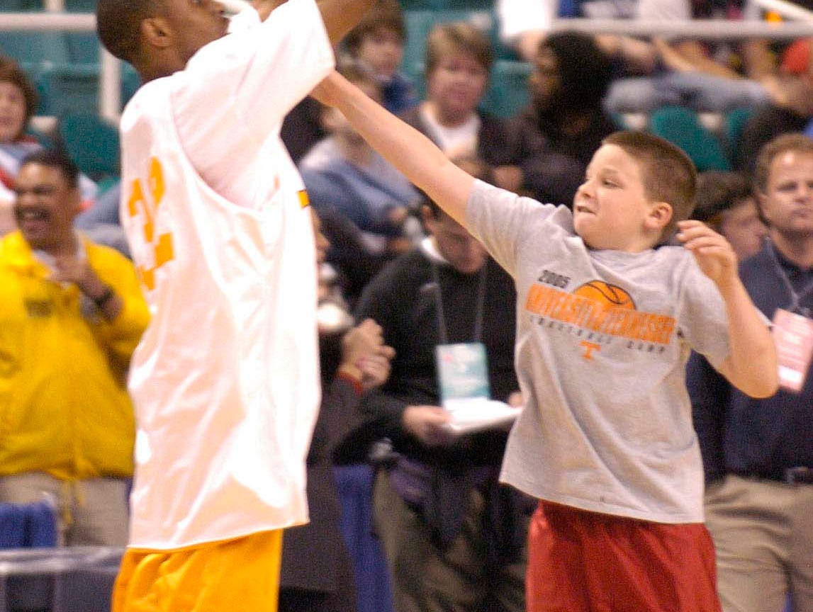 Michael Pearl, son of UT head coach Bruce Pearl, plays defense with senior guard C.J. Watson during practice Wednesday at the Greensboro, N.C., Coliseum . The Volunteers will face Winthrop in the opening round of the 2006 NCAA tournament on Thursday.