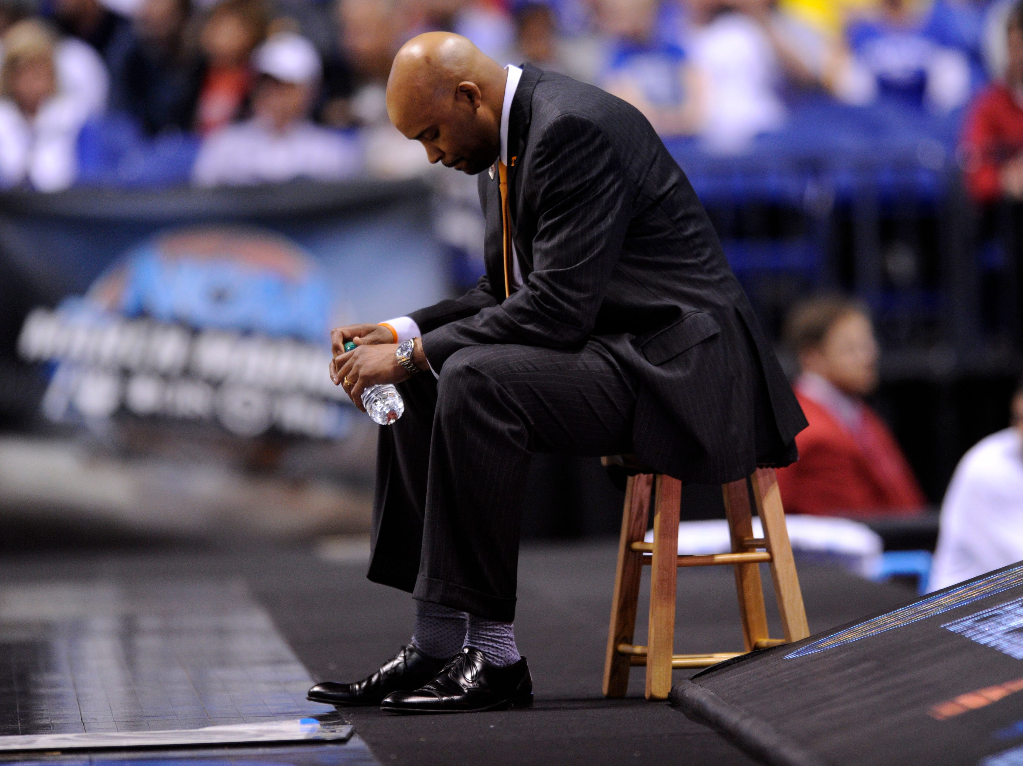 Tennessee head coach Cuonzo Martin sits near his team bench during an NCAA Sweet 16 game at Lucas Oil Stadium in Indianapolis, Ind. on Friday, March 28, 2014.
