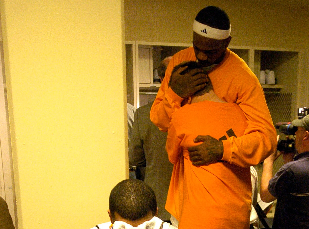 Tennessee senior Chris Lofton cries in the locker room as teammate Tyler Smith gets a consoling hug from Michael Pearl, son of head coach Bruce Pearl, after losing to Louisville during an NCAA Sweet Sixteen regional game in Charlotte, NC in 2008. Tennessee lost the game 79-60 to end their season.