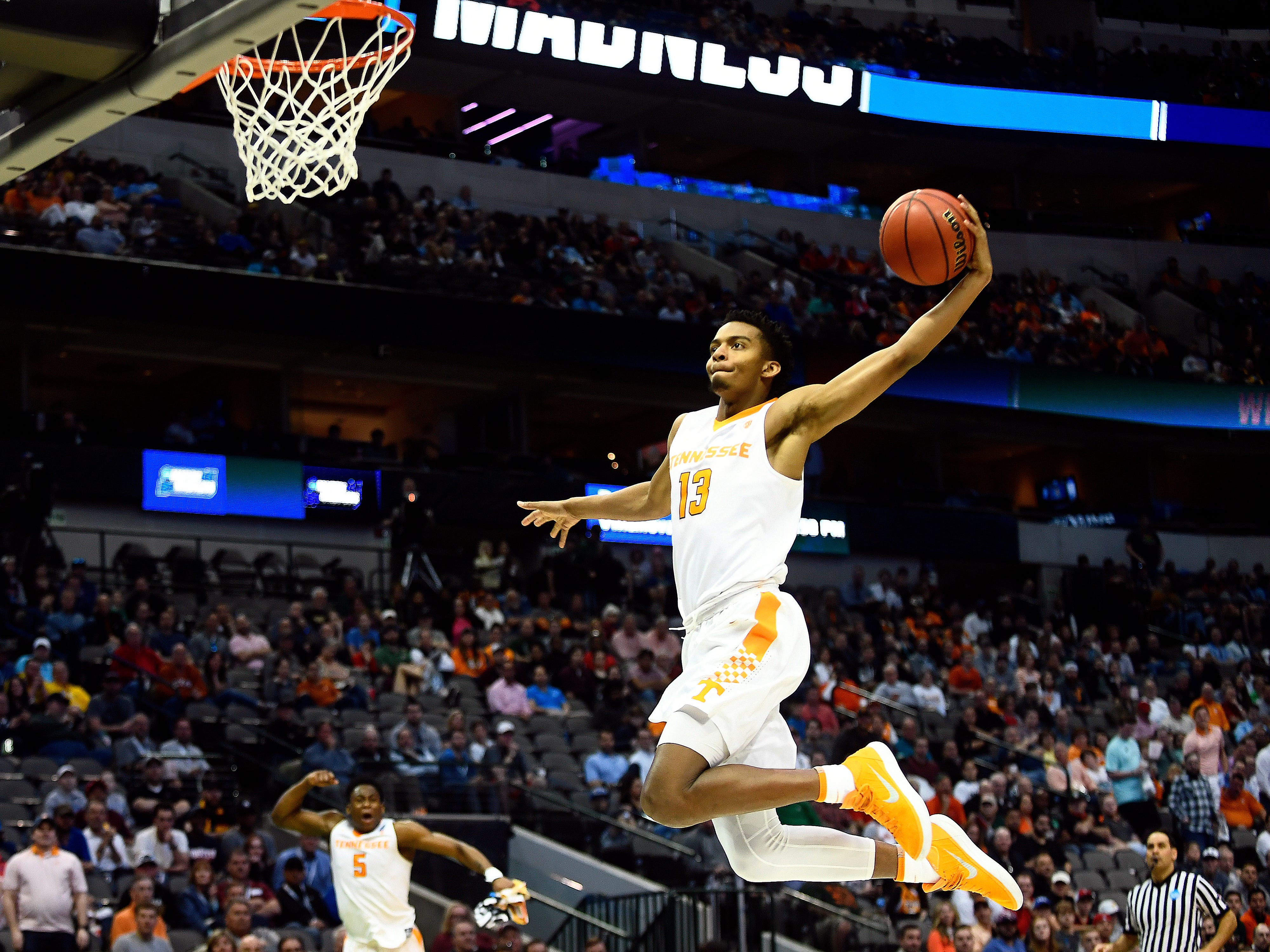 Tennessee guard Jalen Johnson (13) dunks the ball during the NCAA Tournament first round game between Tennessee and Wright State at American Airlines Center in Dallas, Texas, on Thursday, March 15, 2018.