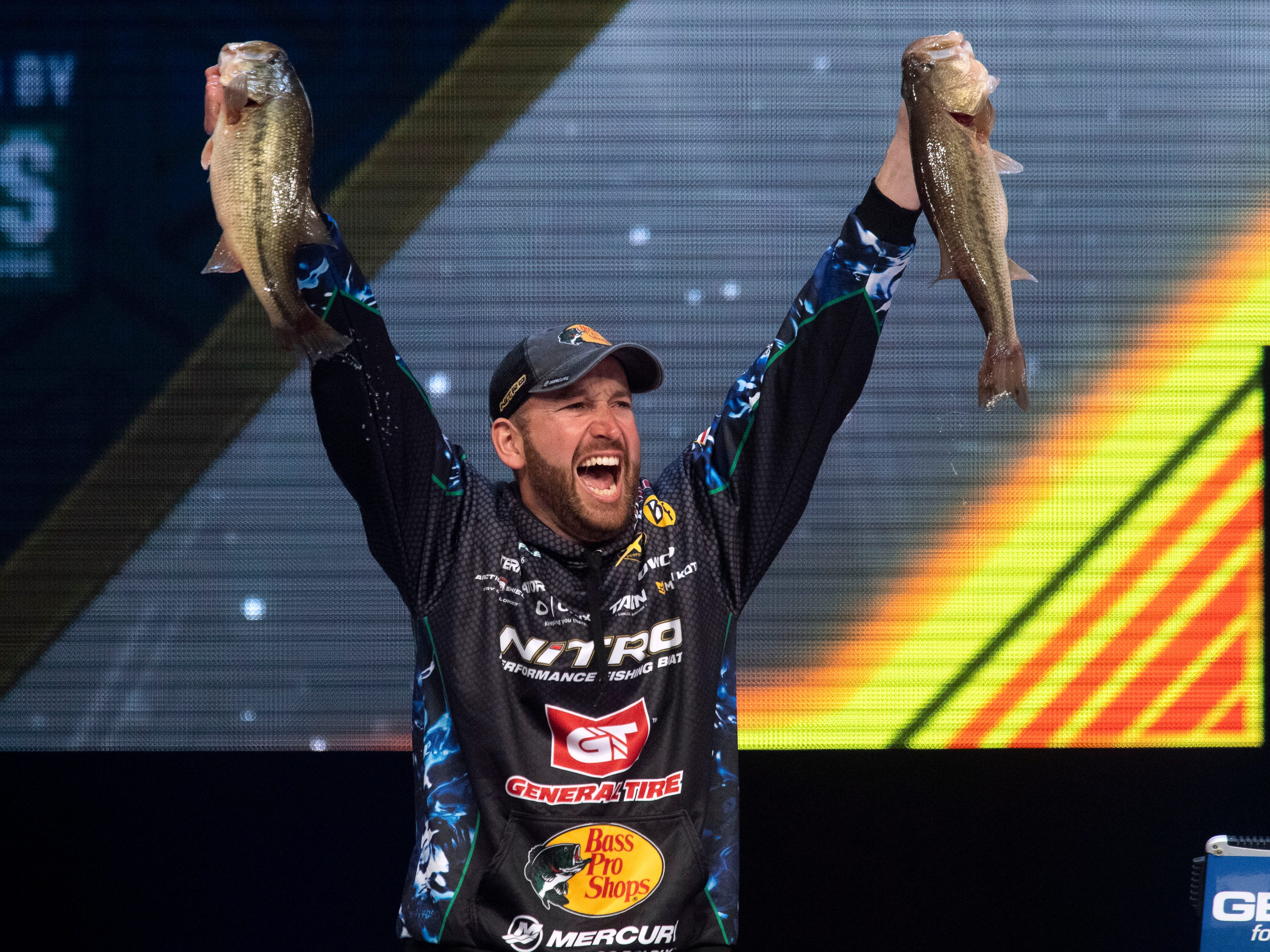 Knoxville's Ott DeFoe shows off his two best in the day's catch to win the 2019 Bassmaster Classic on Sunday, March 17, 2019 during the weigh-in at Thompson-Boling Arena. DeFoe won with a total of 49 lbs and 3 oz. of bass fish over the three day tournament.