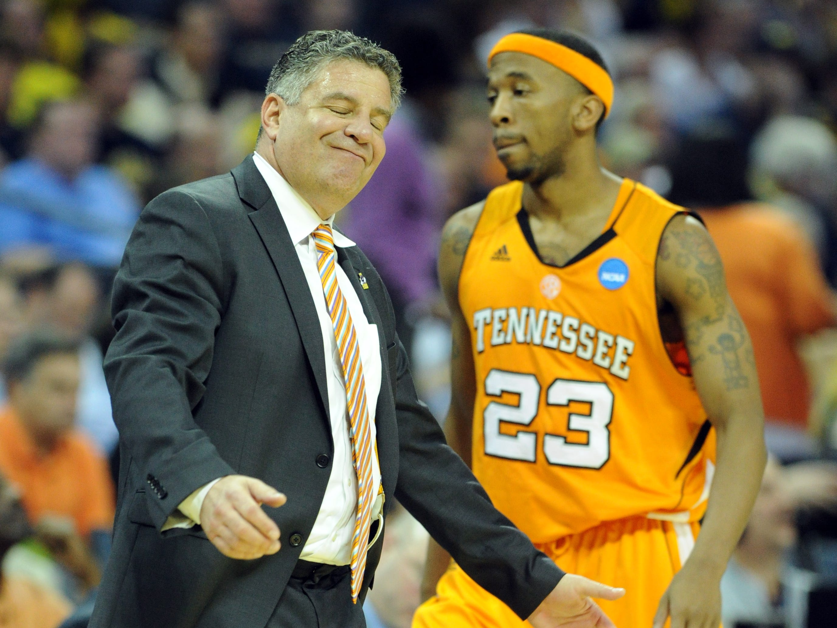 Tennessee head coach Bruce Pearl shakes his head as guard Cameron Tatum heads to the bench during the game against Michigan in the second round of the NCAA Tournament at Time Warner Cable Arena in Charlotte, N.C. Friday, March 18, 2011.  The Vols lost 75-45 to the Wolverines.
