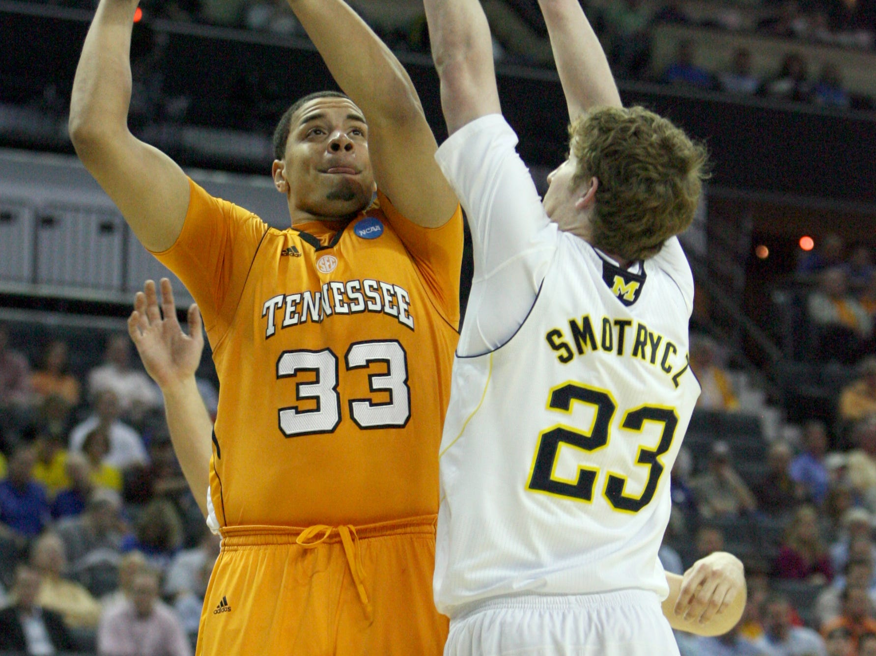 Tennessee center Brian Williams shoots the ball as Michigan forward Evan Smotrycz defends during the second round of the NCAA Tournament at Time Warner Cable Arena in Charlotte, N.C. Friday, March 18, 2011.  Williams scored two points for the Vols during their 75-45 loss to the Wolverines.
