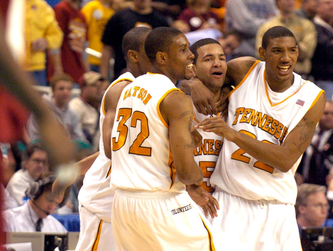 Tennessee teammates C.J. Watson, Stanley Asumnu, and Andre Patterson celebrate with Chris Lofton after he hit a game-winning shot against Winthrop during a first round  2006 NCAA tournament game Thursday at the Greensboro Coliseum in Greensboro, N.C. The Vols won the game 63-61.