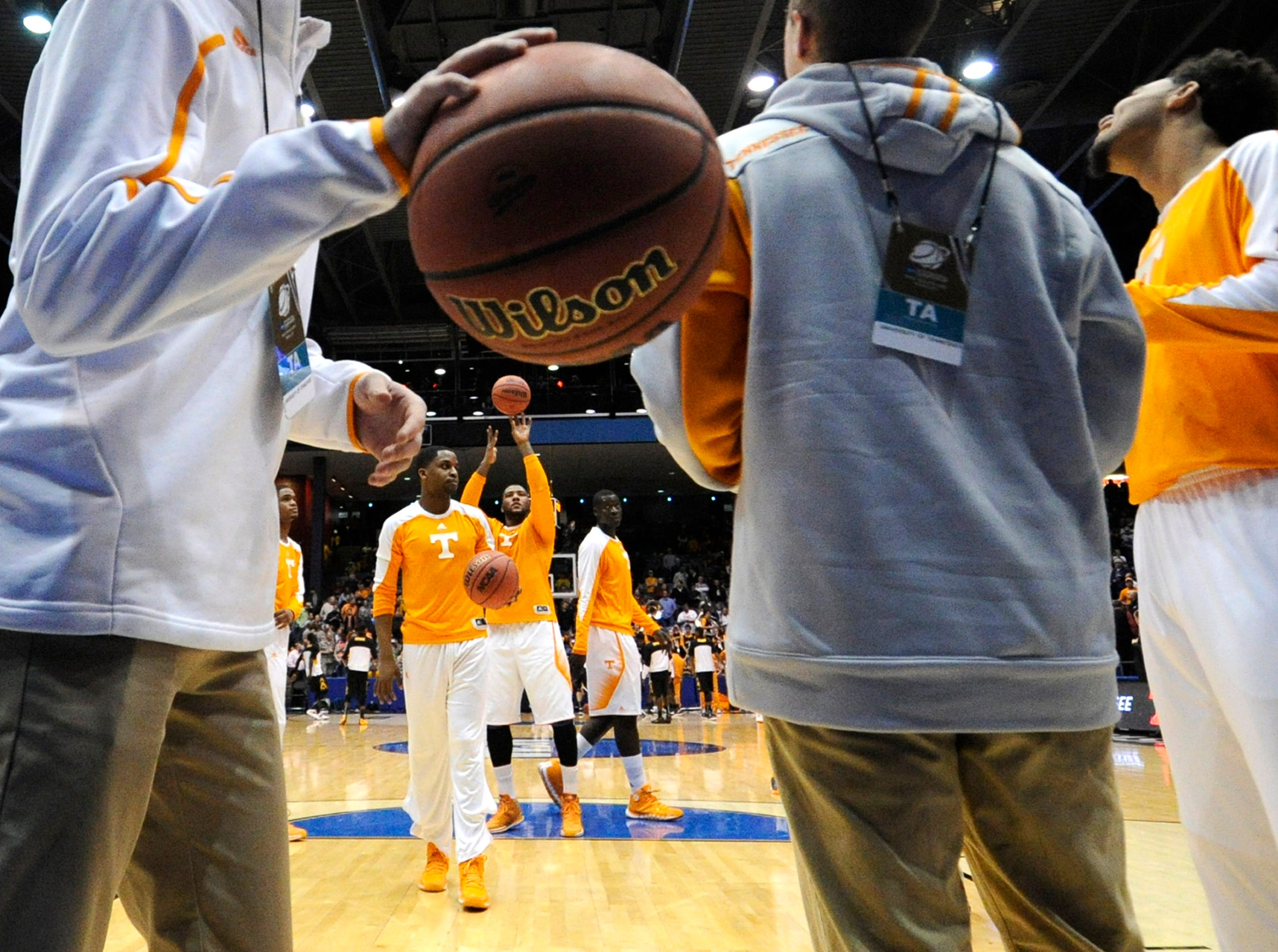 Tennessee players warm up before an NCAA tournament First Four play-in game against Iowa at the University of Dayton Arena in Dayton, Ohio on Wednesday, March 19, 2014.