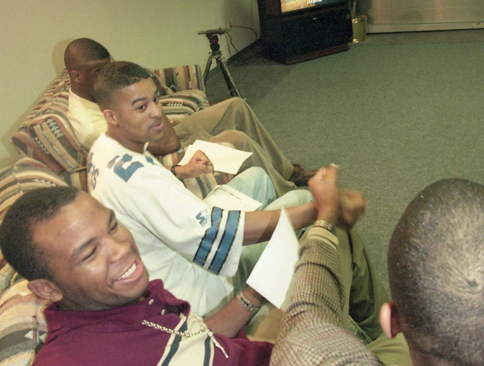 DaShay Jones congratulates Torrey Harris after learning what bracket their tea, is going to play in the NCAA Tournament in 1998.