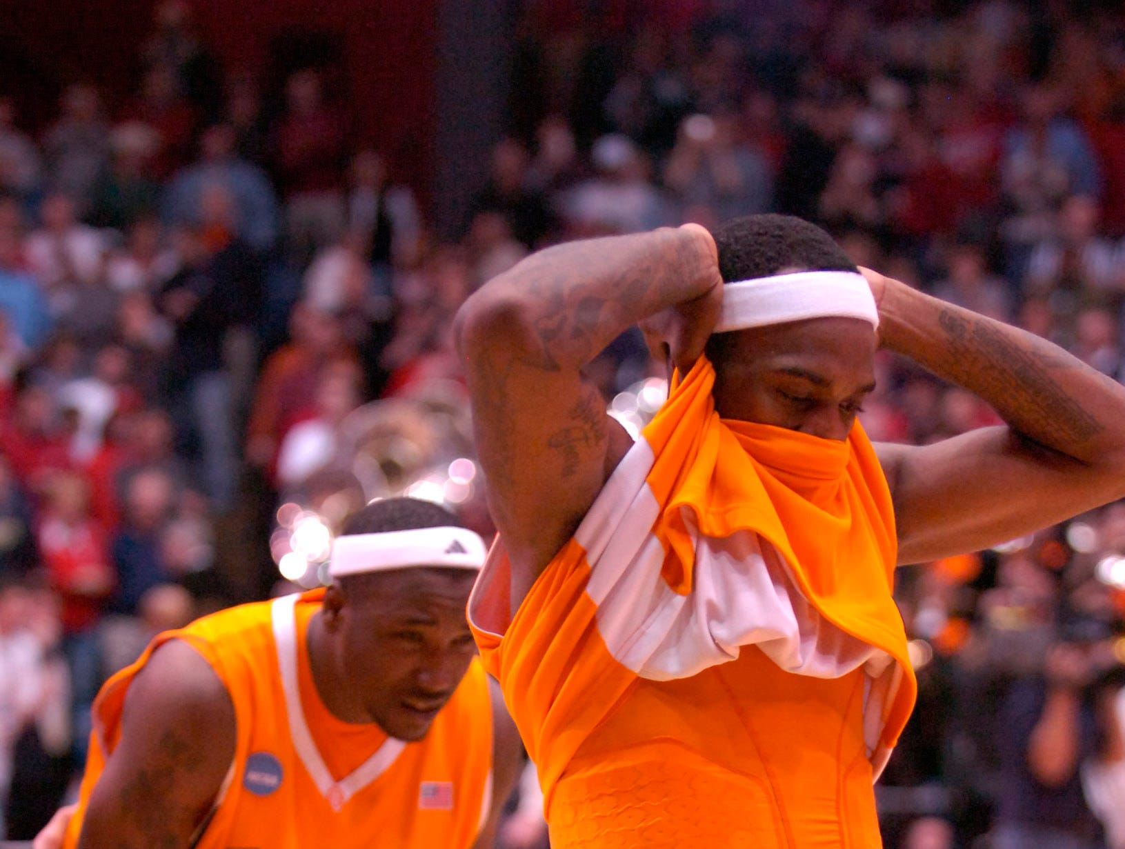 Tennessee's Tyler Smith leaves the floor with teammate Wayne Chism after missing a shot for three points with one second remaining against Oklahoma State during the first round of the 2009 NCAA tournament in Dayton, OH on Friday. UT lost the game 77-75 ending their post season play.