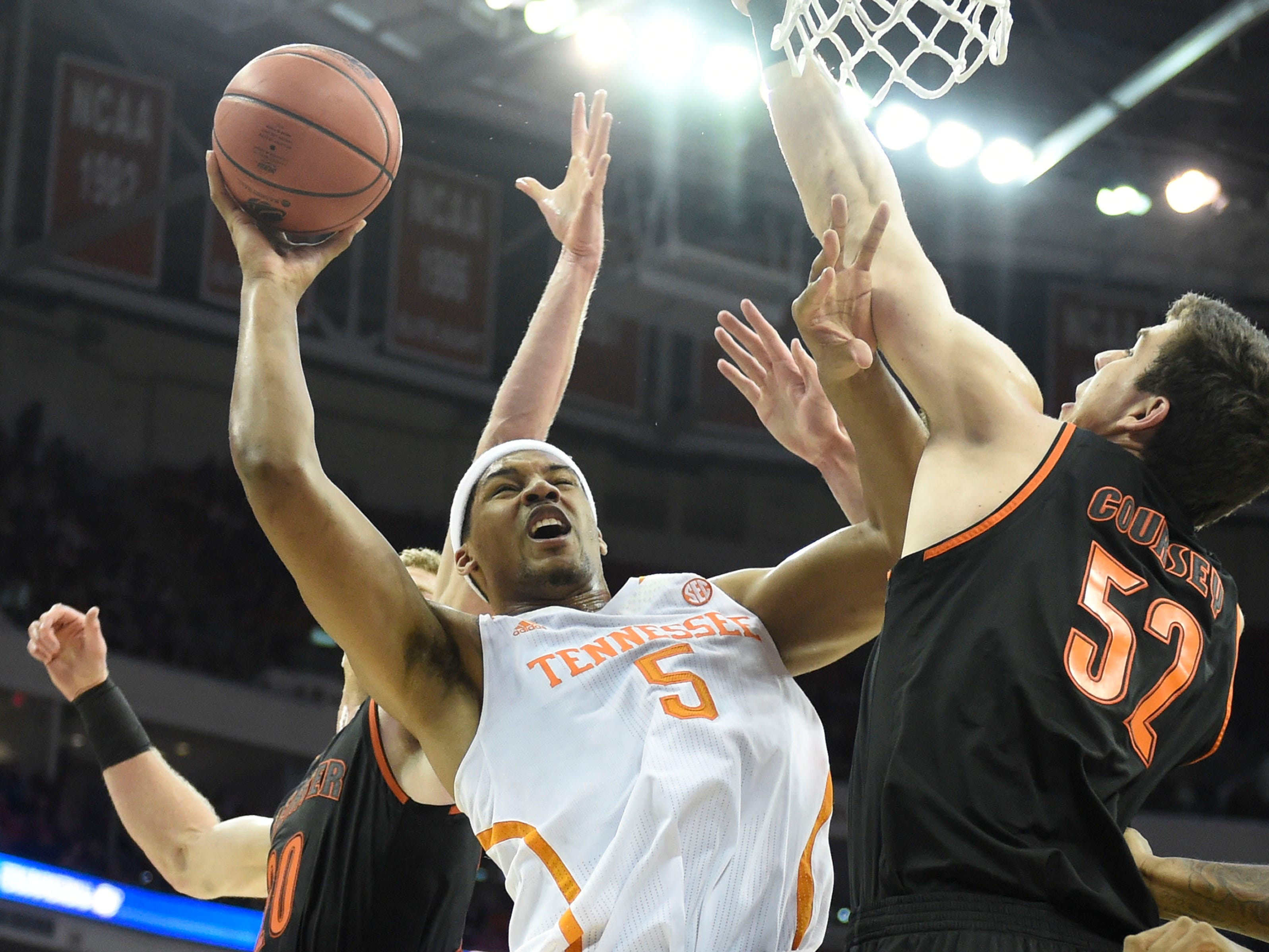 Tennessee forward Jarnell Stokes (5) goes up for a layup against Mercer forward Daniel Coursey (52) during the first half of a third-round NCAA tournament game at the PNC Arena in Raleigh, N.C. on Sunday, March 23, 2014.