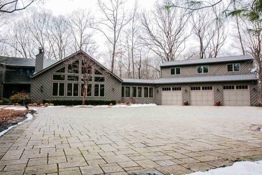 Built in 1977, this three bedroom two and a half bath home holds 5,137 square feet of space. The unique siding consists of 50/50 knot free redwood and cedar that has been recently painted. The landscaped yard offers a formal garden, fountain and gazebo among the leaf shaped paver driveway.