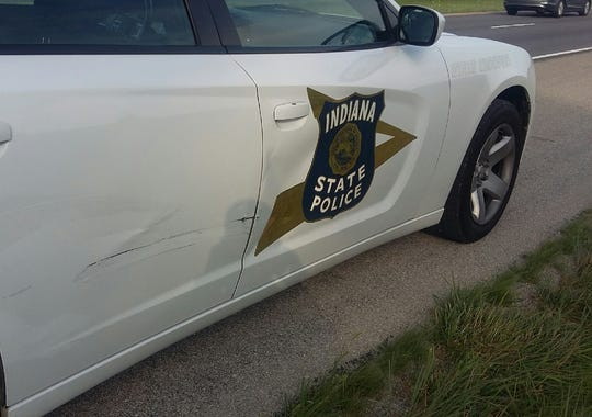 Indiana State Police released the name of the woman shot while driving on Interstate 65 early Friday.