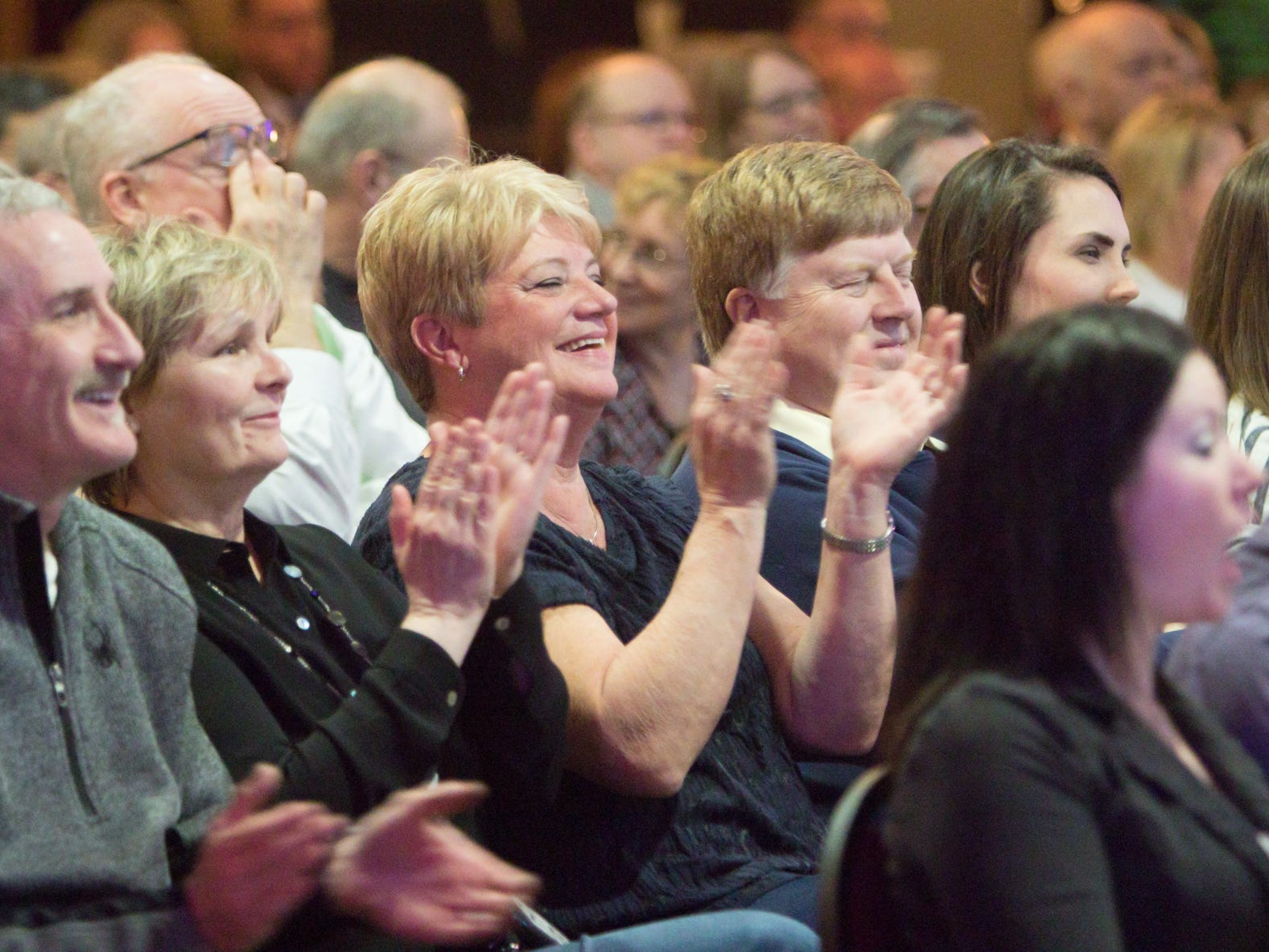 Audience members laugh and applaud the comedy of Harry Artin Berberian at Love, INC's comedy night fundraiser Thursday, March 14, 2019.