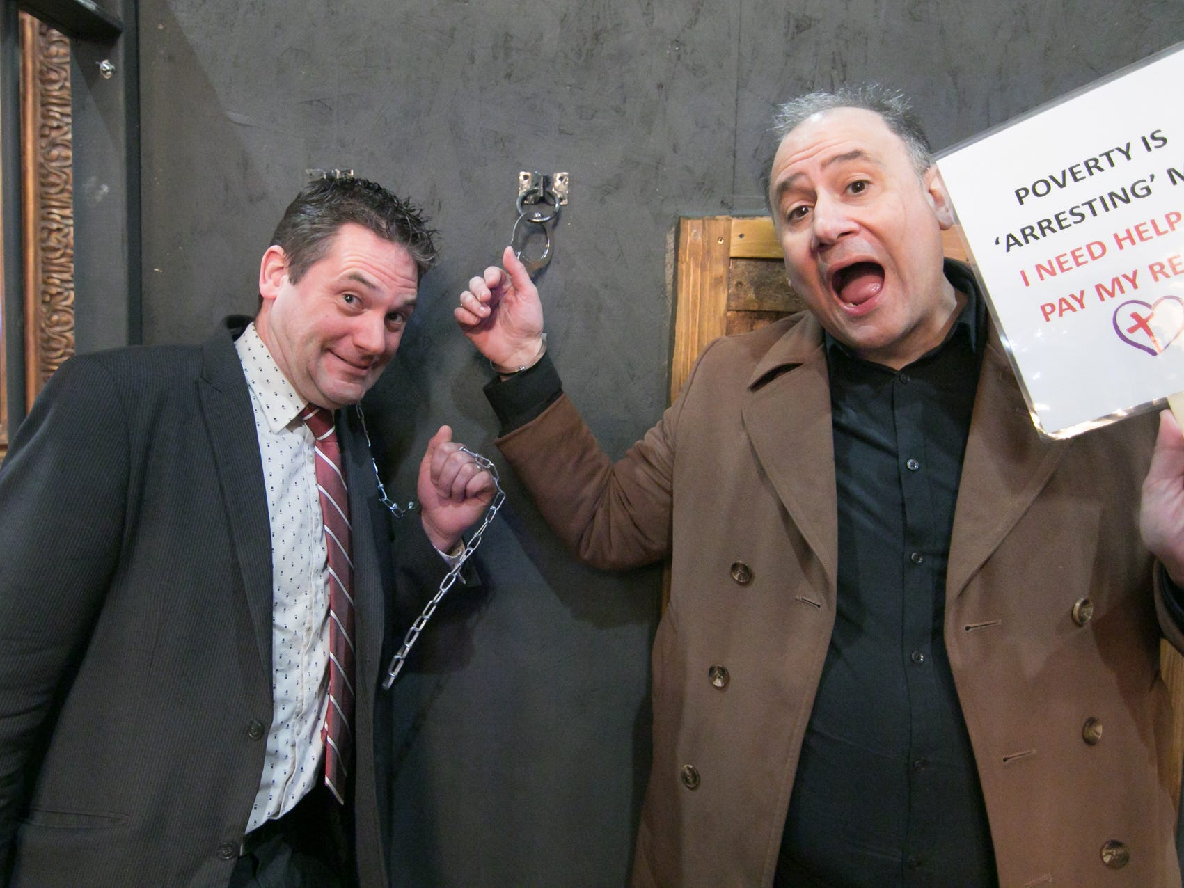 Jason Abbott, left, and comedian/emcee Harry Berberian are 'incarcerated,' needing $5 apiece to get them bailed out of jail at the Love, INC comedy night fundraiser Thursday, March 14, 2019.