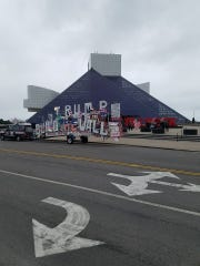 "Rob Cortis's ""Trump Unity Bridge"" was decorated with large letters spelling out ""Build the Wall"" when he disrupted a vigil in Cleveland for New Zealand mosque shooting victims. The float is shown near the Rock & Roll Hall of  Fame"