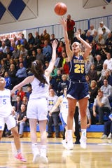 Hartland's 6-foot-4 junior center, Whitney Sollom (25), didn't play when the Eagles lost to Saginaw Heritage on Dec. 11.