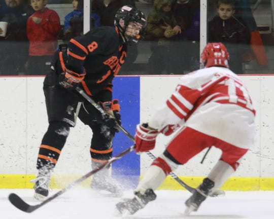 Brighton defenseman Tim Erkkila (8) is a three-time all-state hockey selection and a two-time Dream Team pick.