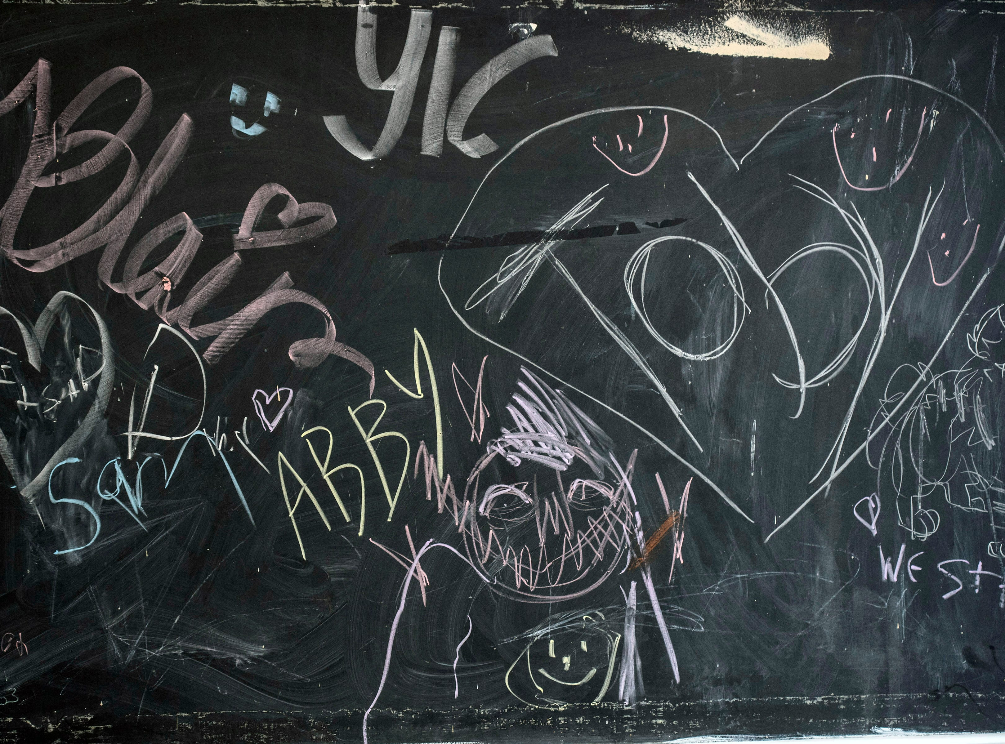 A chalkboard at a new LGBTQIA+ safe space on East Broadway encourages free expression without judgement. 3/15/19