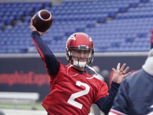 Memphis Express quarterback Johnny Manziel throws a pass during Monday's light workout at Liberty Bowl Memorial Stadium.