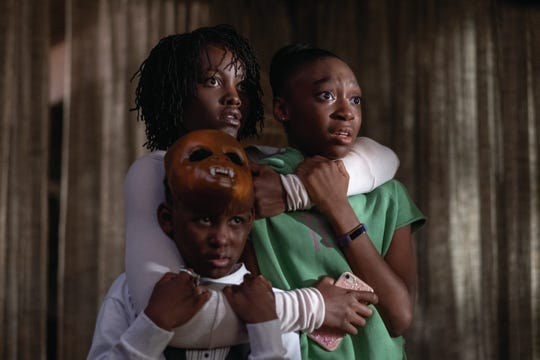 """Jason Wilson (Evan Alex, from left), Adelaide Wilson (Lupita Nyong'o) and Zora Wilson (Shahadi Wright Joseph) stare into the face of a different form of evil in """"Us."""""""