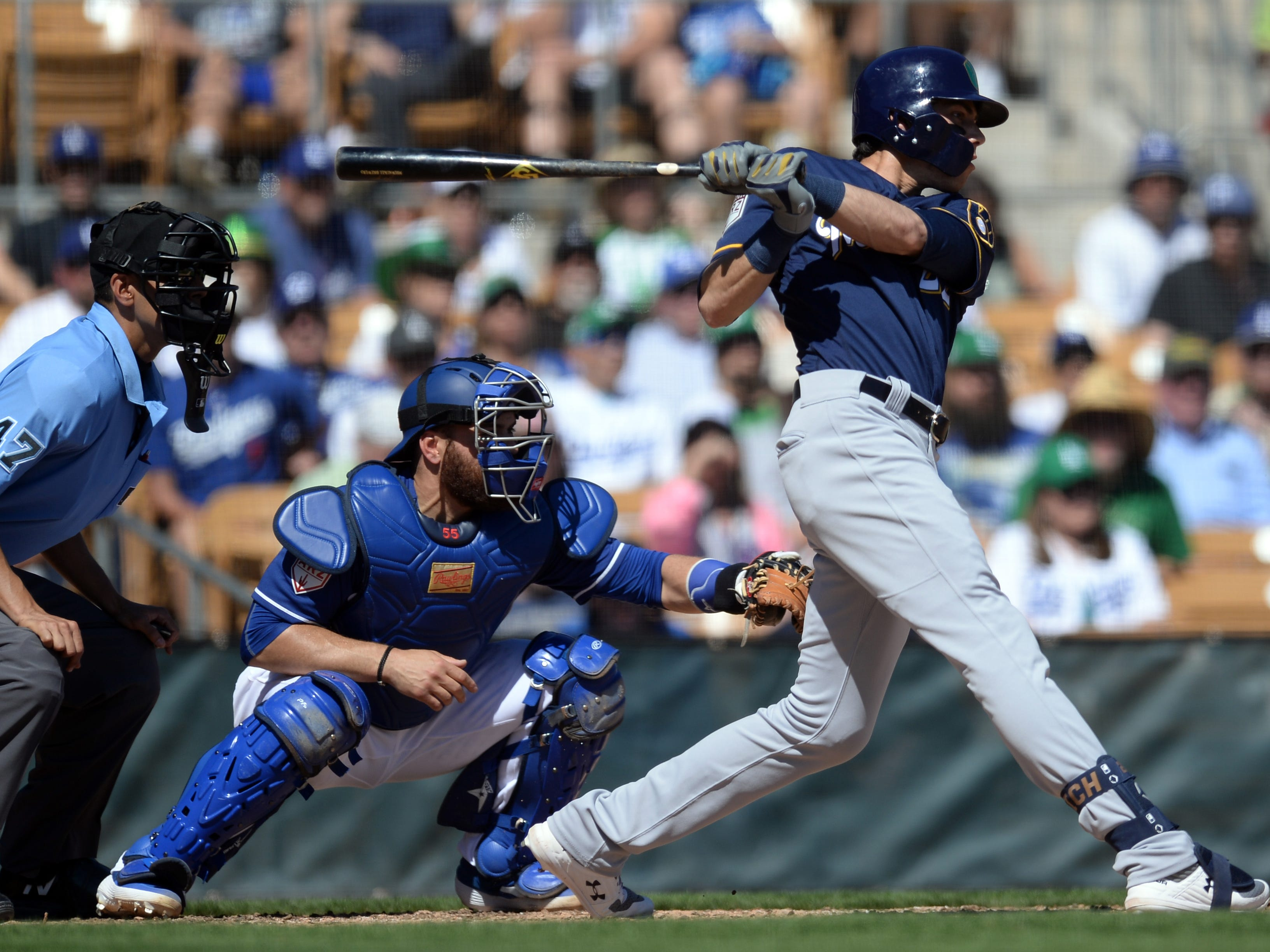 Christian Yelich of the Brewers cracks a single against the Dodgers during the third inning. Yelich, the reigning NL MVP, is hitting .500 this spring.