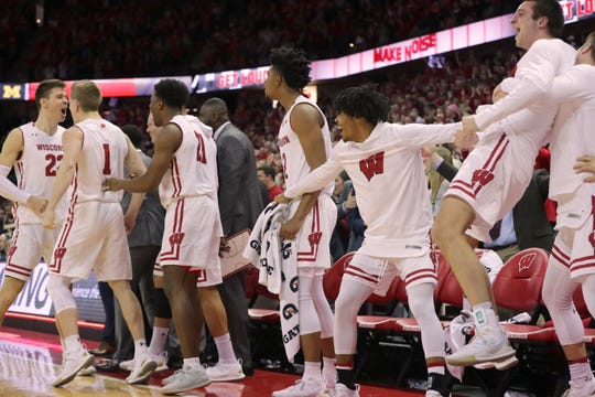 Wisconsin forward Ethan Happ (left) and his teammates celebrate toward the end of their game Jan. 19 against Michigan at the Kohl Center in Madison.
