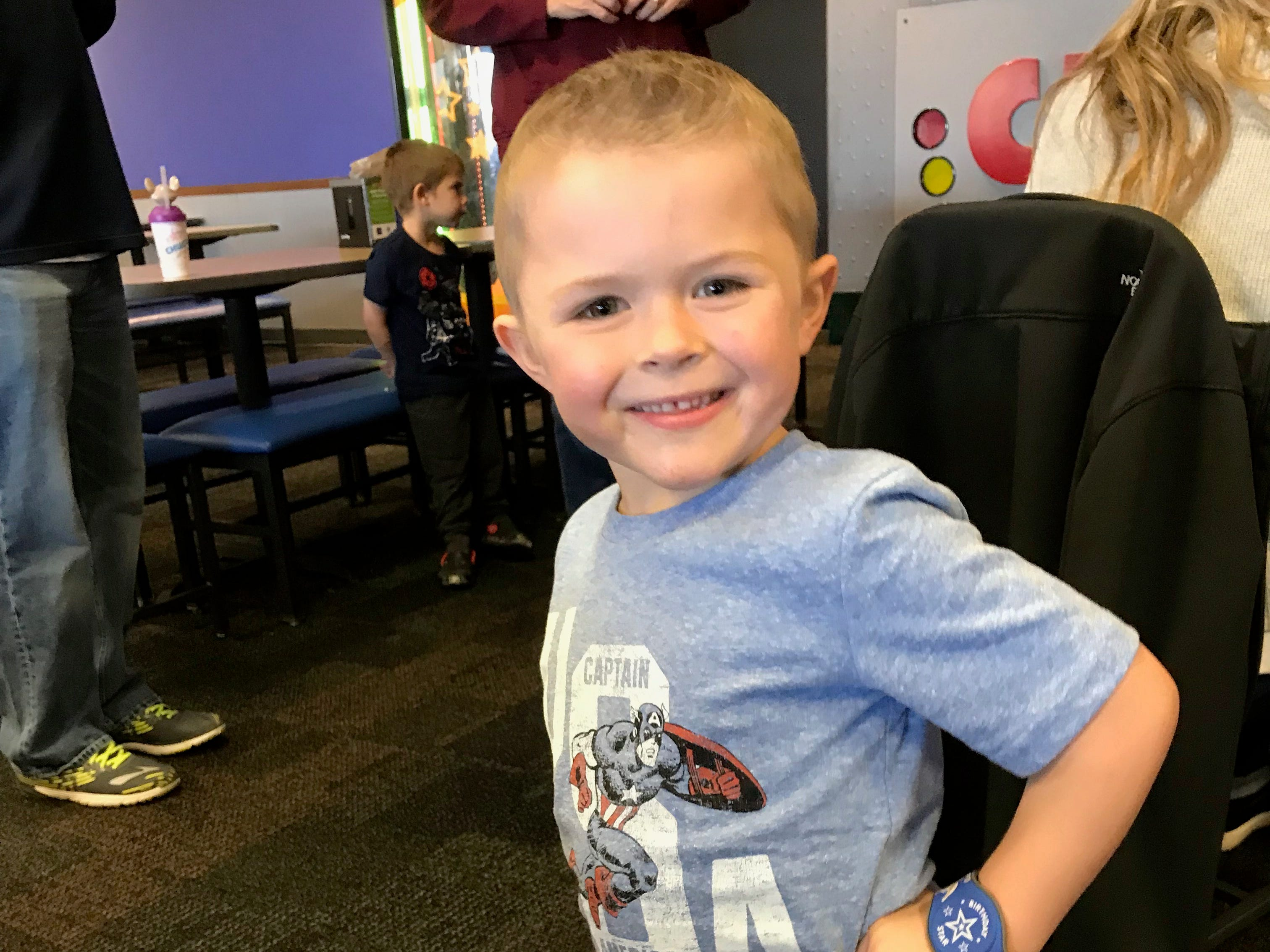 Five-year-old Lincoln Maziasz, who is going through treatment for leukemia, poses at his birthday party at Chuck E. Cheese.