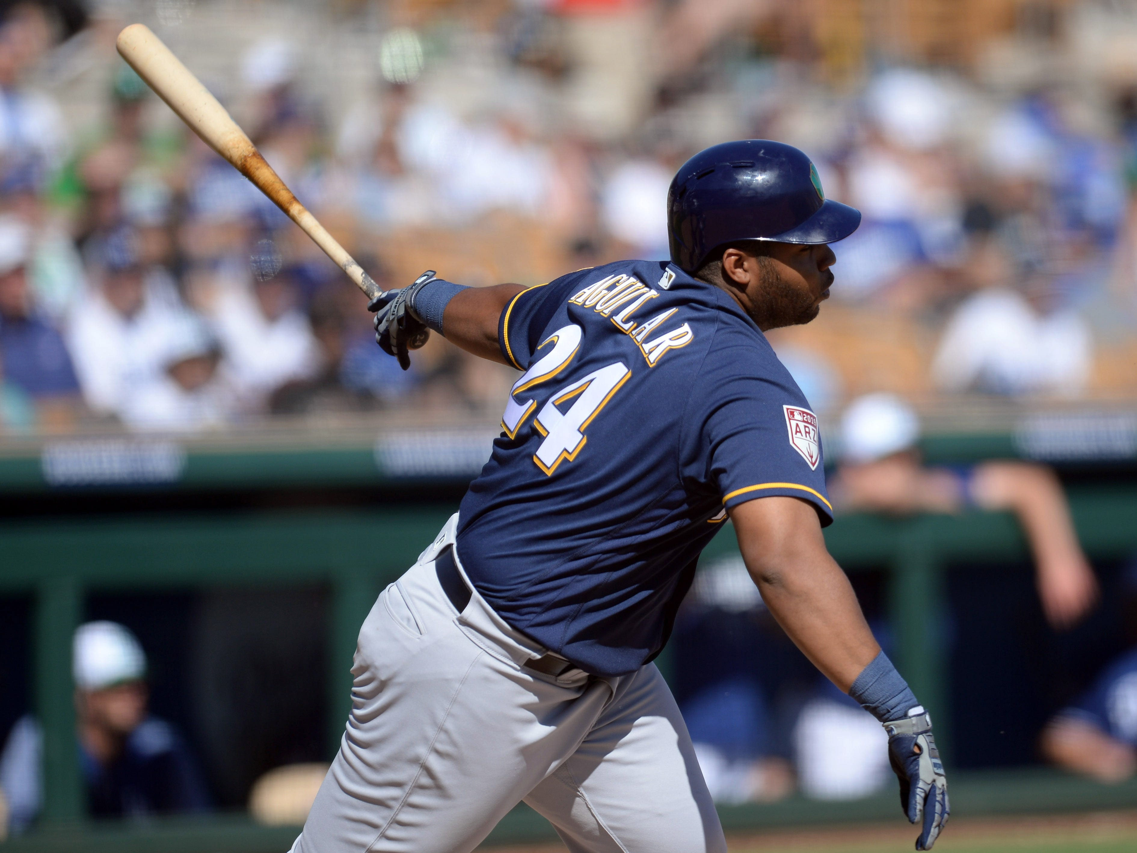 Brewers first baseman Jesus Aguilar reaches base with his second single on the day against the Dodgers in the fifith inning Sunday.