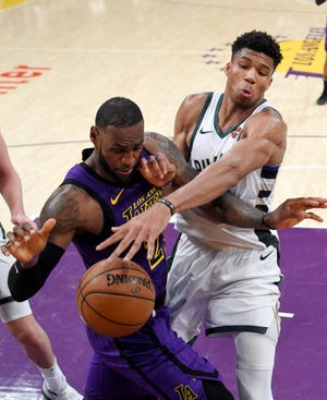 Giannis Antetokounmpo, knocks the ball from LeBron James during the first Bucks-Lakers meeting this season on March 1.