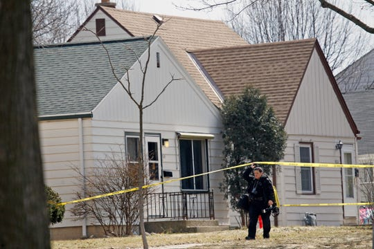 Milwaukee Police Department forensic staff leaves the scene where there was a report of a possible murder-suicide on Monday, March 18, 2019, in the 3500 block of 58th street. A 27-year-old woman and a 26-year-old man are dead following an apparent murder-suicide in the Sherman Park neighborhood, Milwaukee police said. No other information available.