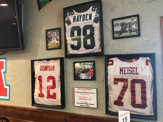 Endter's proudly displays the jerseys of three local sports heroes including Nick Hayden, Tyler Donovan and Todd Meisel.