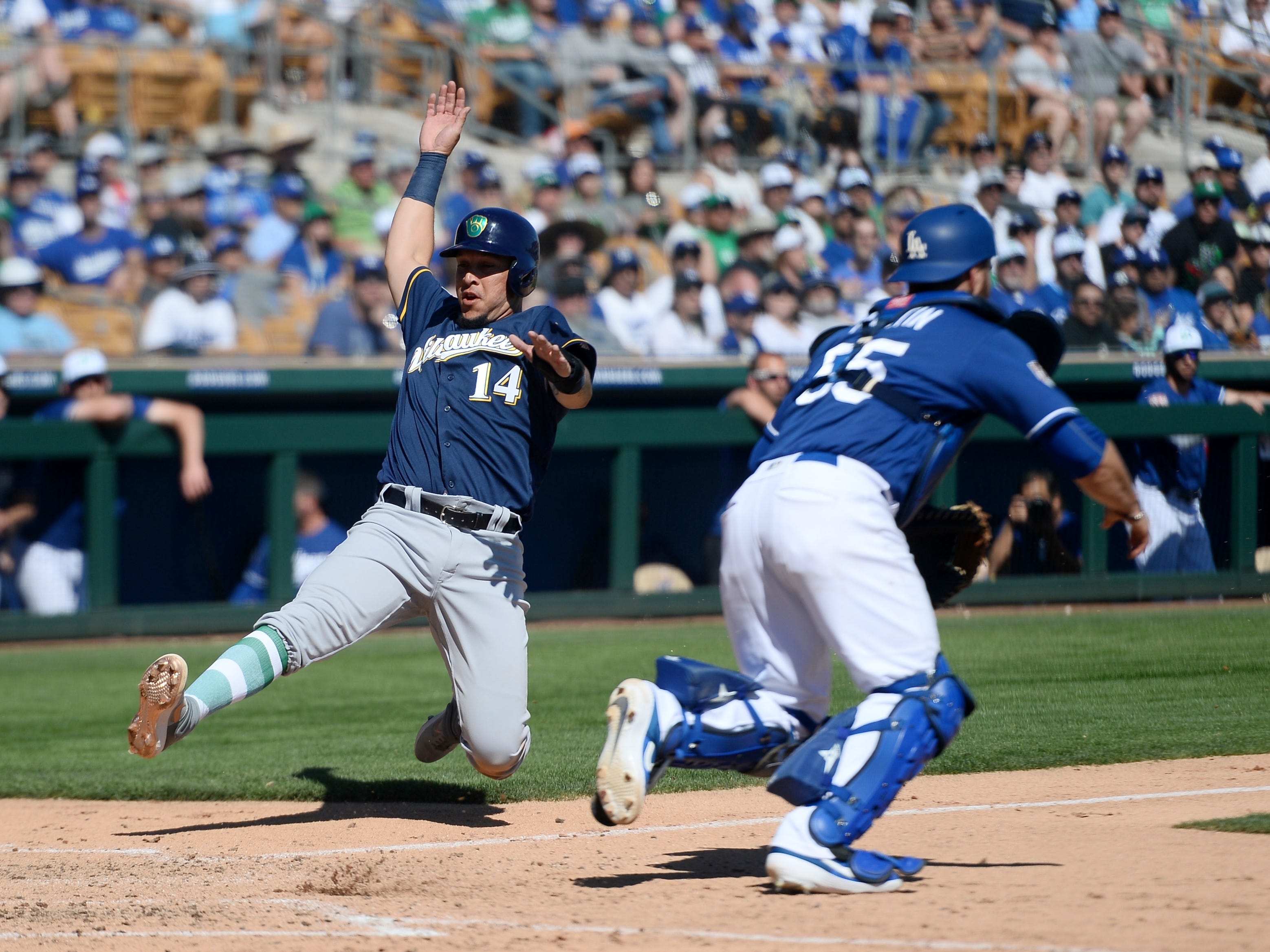 Hernan Perez comes flying across home with the Brewers first run against the Dodgers as he scores on a single by Jesus Aguilar in the third inning.