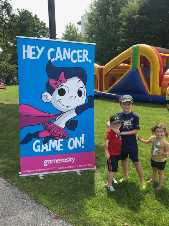 Lincoln, Carter and Layne Maziasz enjoy themselves at Game On! by Gamerosity.