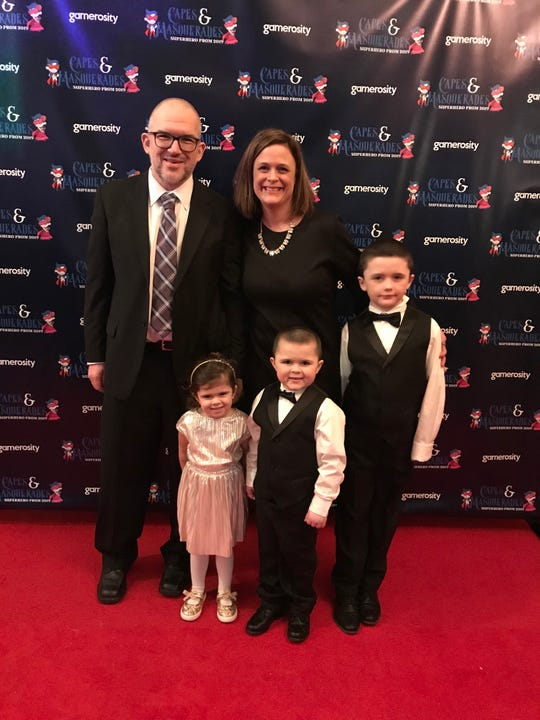 Lincoln, Layne and Carter Maziasz pose with their parents, Andrew and Katherine, at the Gamerosity family prom.