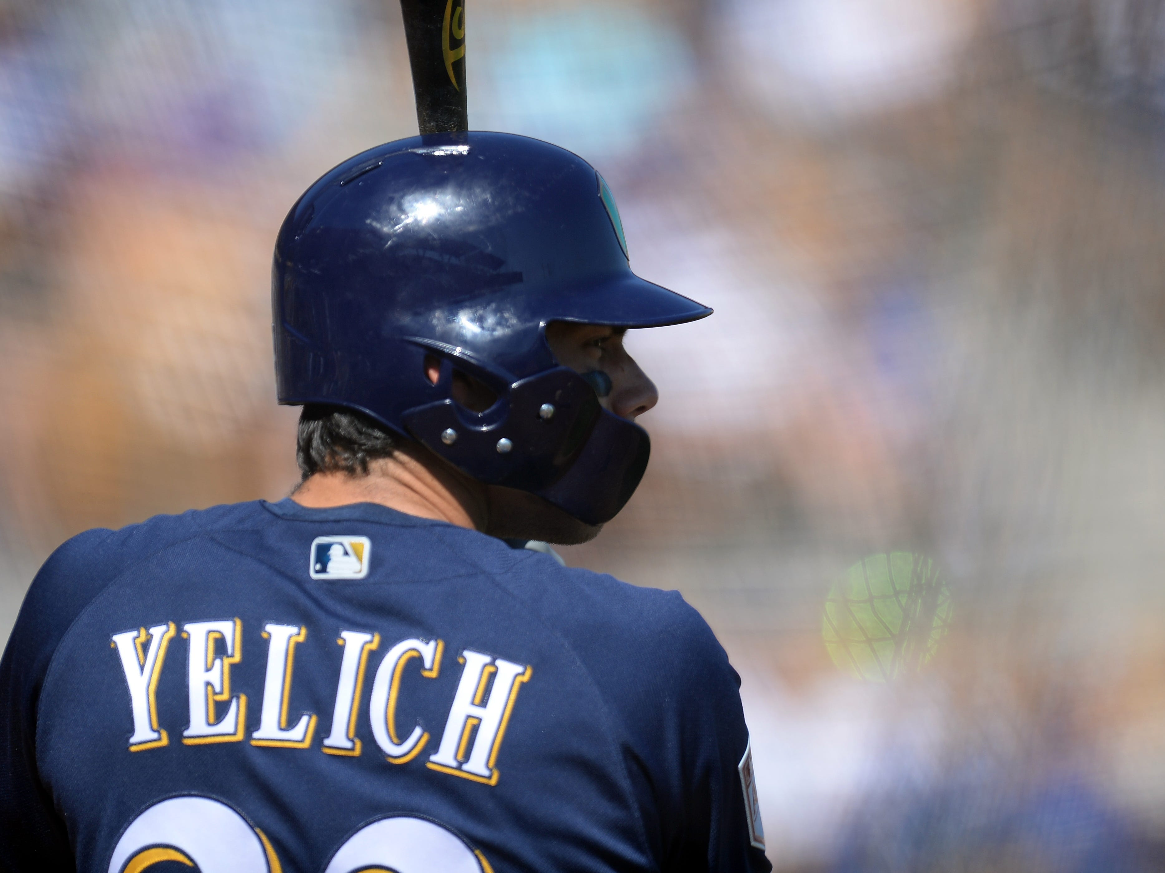 Christian Yelich bides his time in the Brewers on-deck circle during the fifth inning in a game against the Dodgers on Sunday.